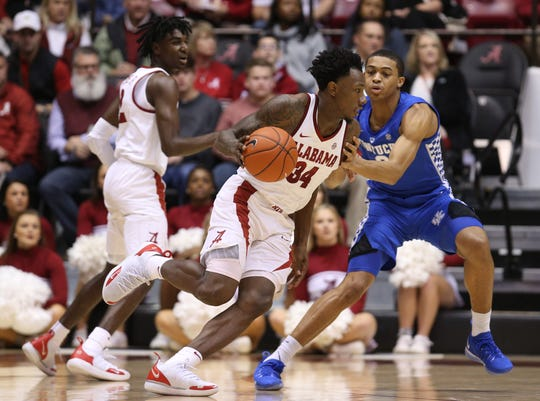 Jan 5, 2019; Tuscaloosa, AL, USA; Alabama Crimson Tide guard Tevin Mack (34) drives to the basket against Kentucky Wildcats during the first half at Coleman Coliseum. Mandatory Credit: Marvin Gentry-USA TODAY Sports