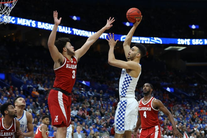 Kentucky forward Sacha Killeya-Jones (1) puts up a shot against Alabama forward Alex Reese (3) during the second half of the semifinals of the SEC Tournament on March 10, 2018. Kentucky won 86-63.