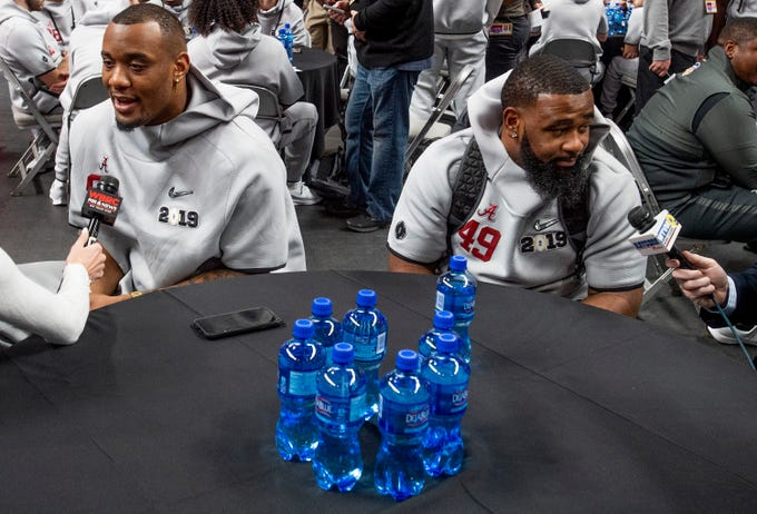 Alabama defensive lineman Raekwon Davis (99) and Alabama defensive lineman Isaiah Buggs (49) during the Alabama Media Day at the SAP Center in San Jose, Ca., on Saturday January 5, 2019.