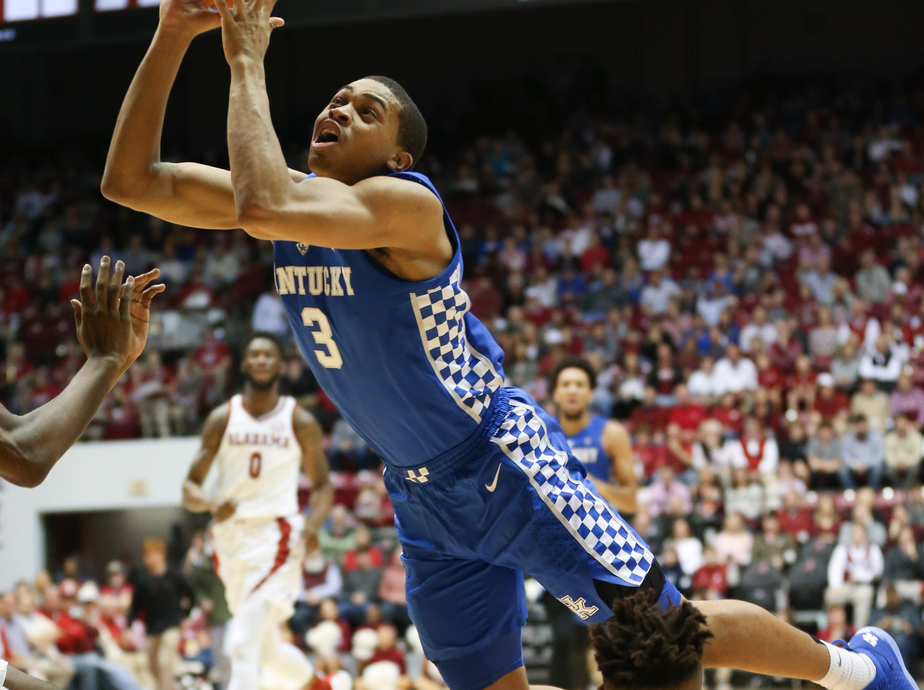 Jan 5, 2019; Tuscaloosa, AL, USA; Kentucky Wildcats guard Keldon Johnson (3) goes to the basket against Alabama Crimson Tide guard Avery Johnson Jr. (5)  during the first half at Coleman Coliseum. Mandatory Credit: Marvin Gentry-USA TODAY Sports