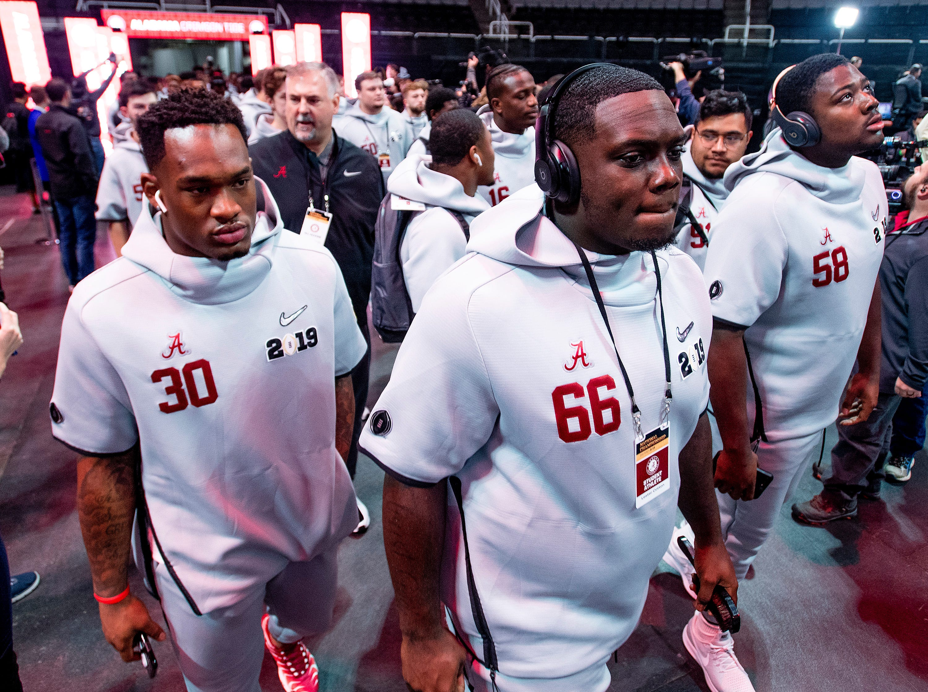 Alabama linebacker Mack Wilson (30) offensive lineman Lester Cotton (66) and defensive lineman Christian Barmore (58) arrive with the team for the Alabama Media Day at the SAP Center in San Jose, Ca., on Saturday January 5, 2019.