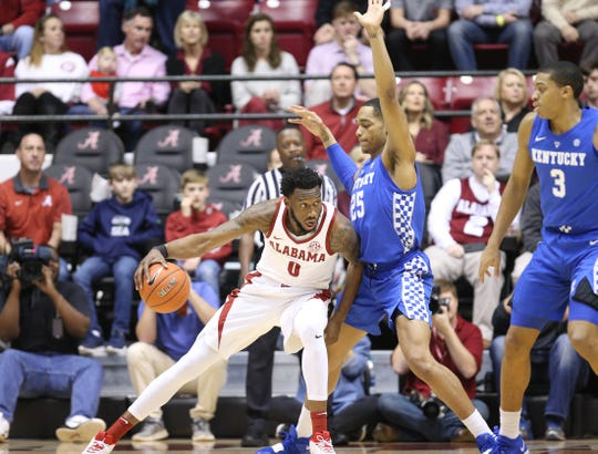 Jan 5, 2019; Tuscaloosa, AL, USA; Alabama Crimson Tide forward Donta Hall (0) drives to the basket against Kentucky Wildcats forward PJ Washington (25) during the first half at Coleman Coliseum. Mandatory Credit: Marvin Gentry-USA TODAY Sports