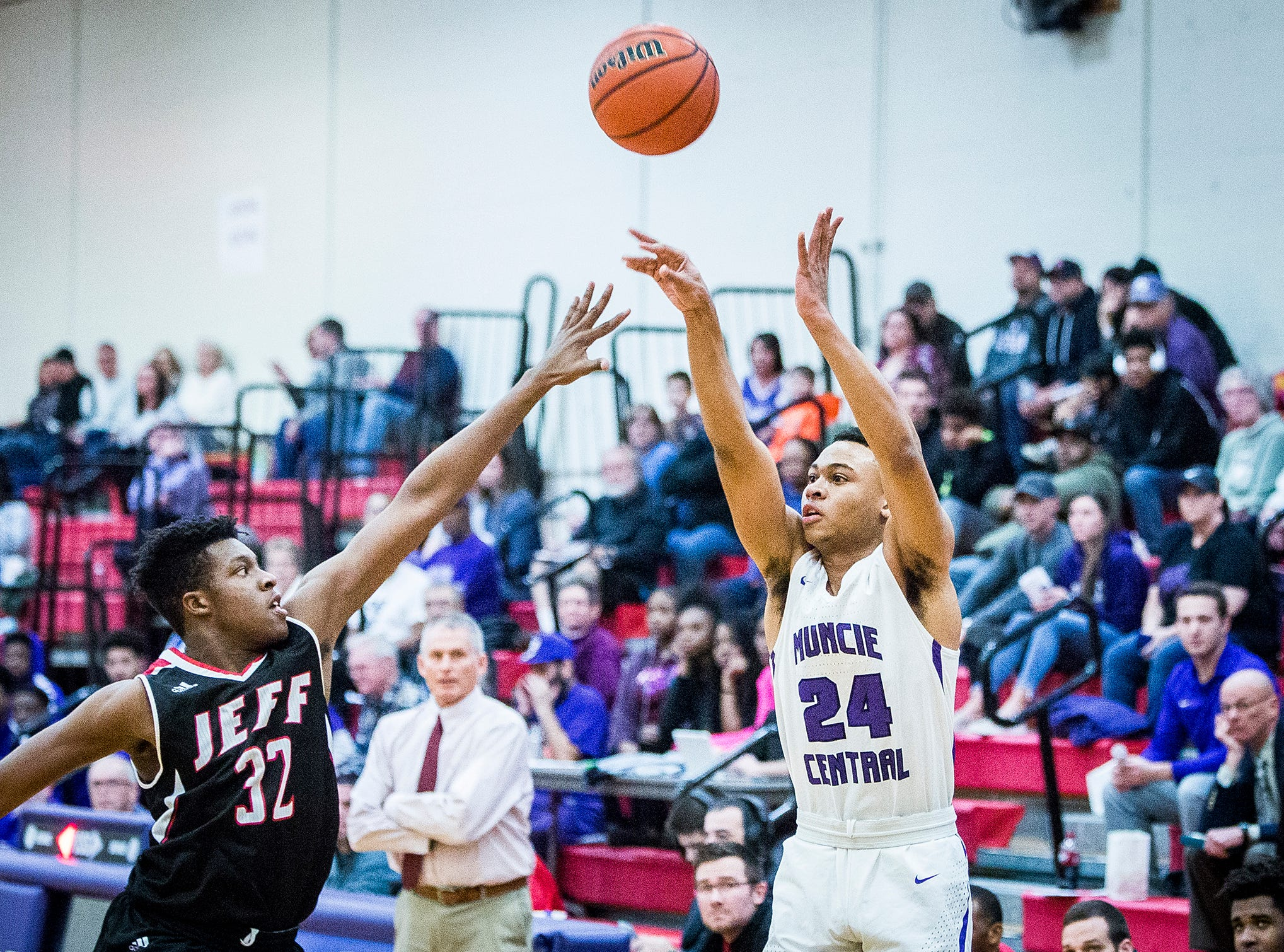 Central's Victor Young shoots past Lafayette Jefferson's defense during their game at Southside Middle School Friday, Jan. 4, 2019.