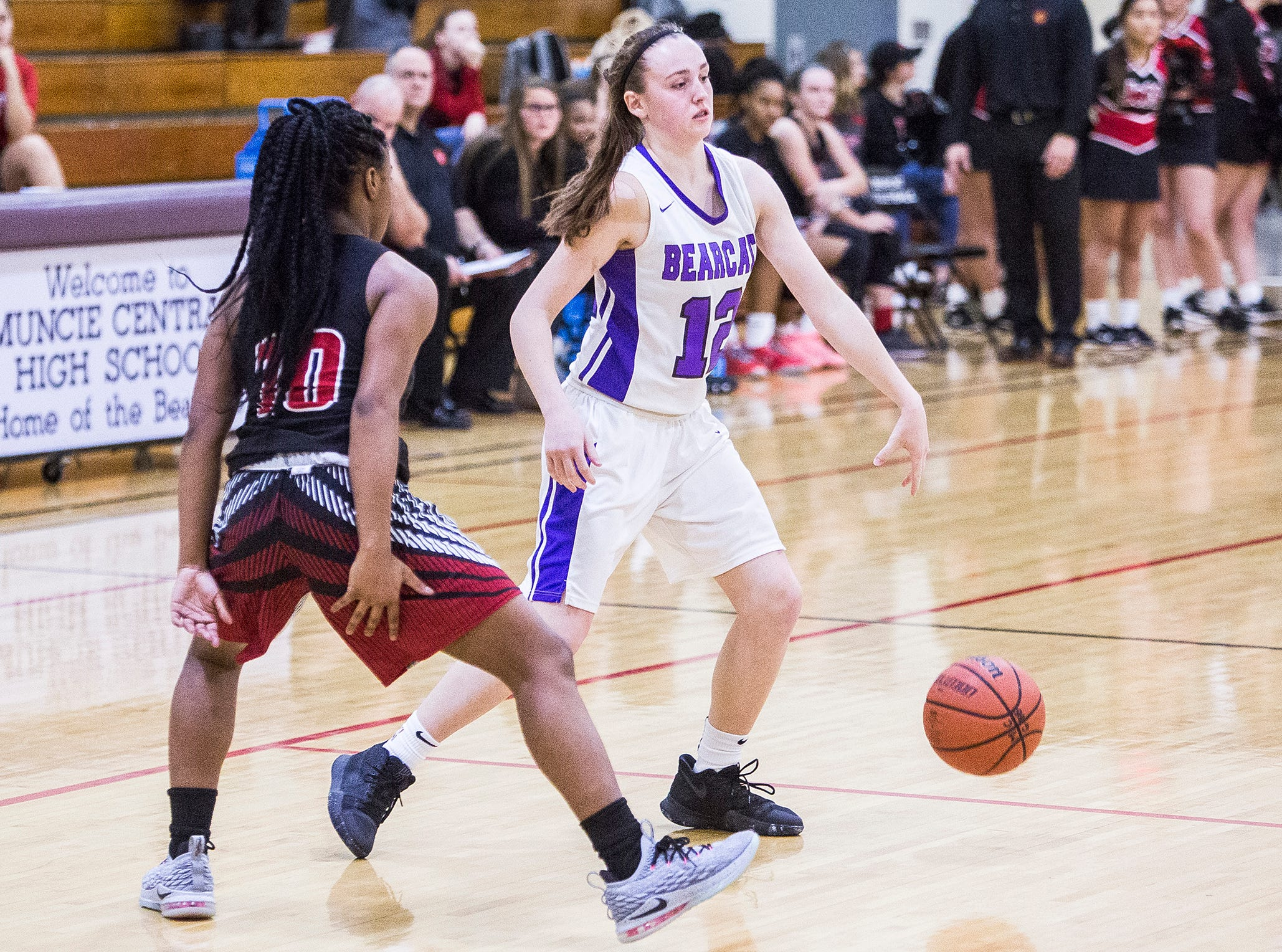 Central's Ayala Wilson dribbles against Lafayette Jeff's defense during their game at Central Friday, Jan. 4, 2019.
