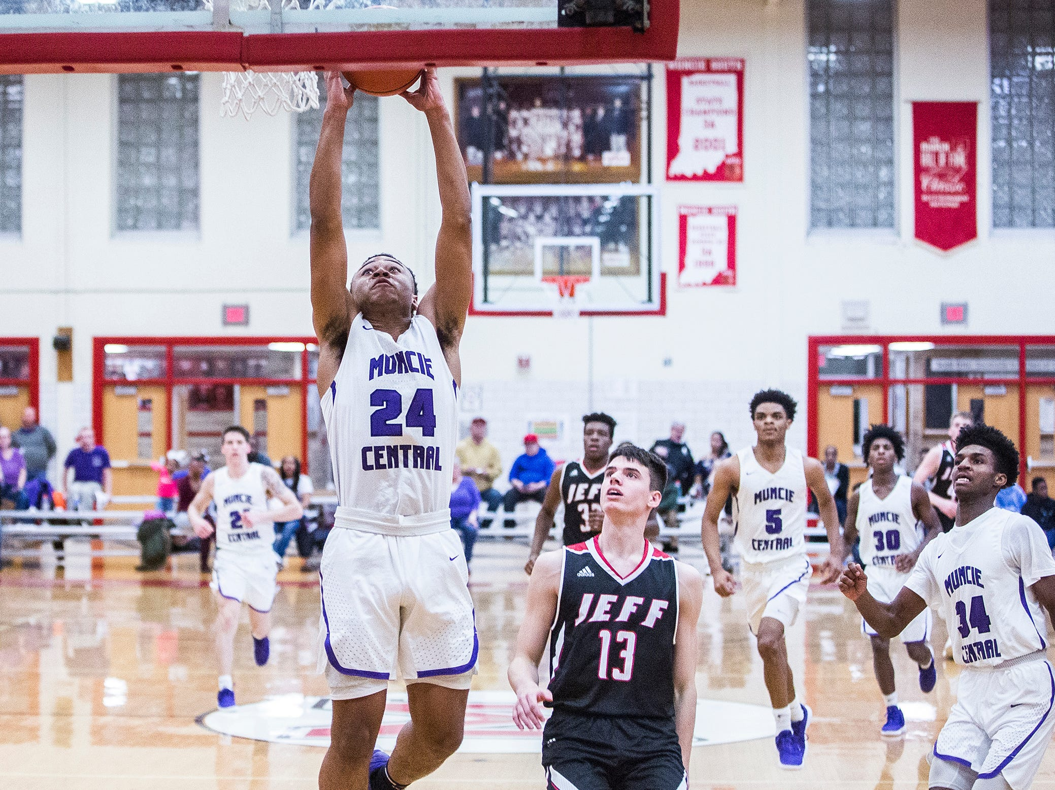 Central's Victor Young goes to the rim against Lafayette Jefferson during their game at Southside Middle School Friday, Jan. 4, 2019.