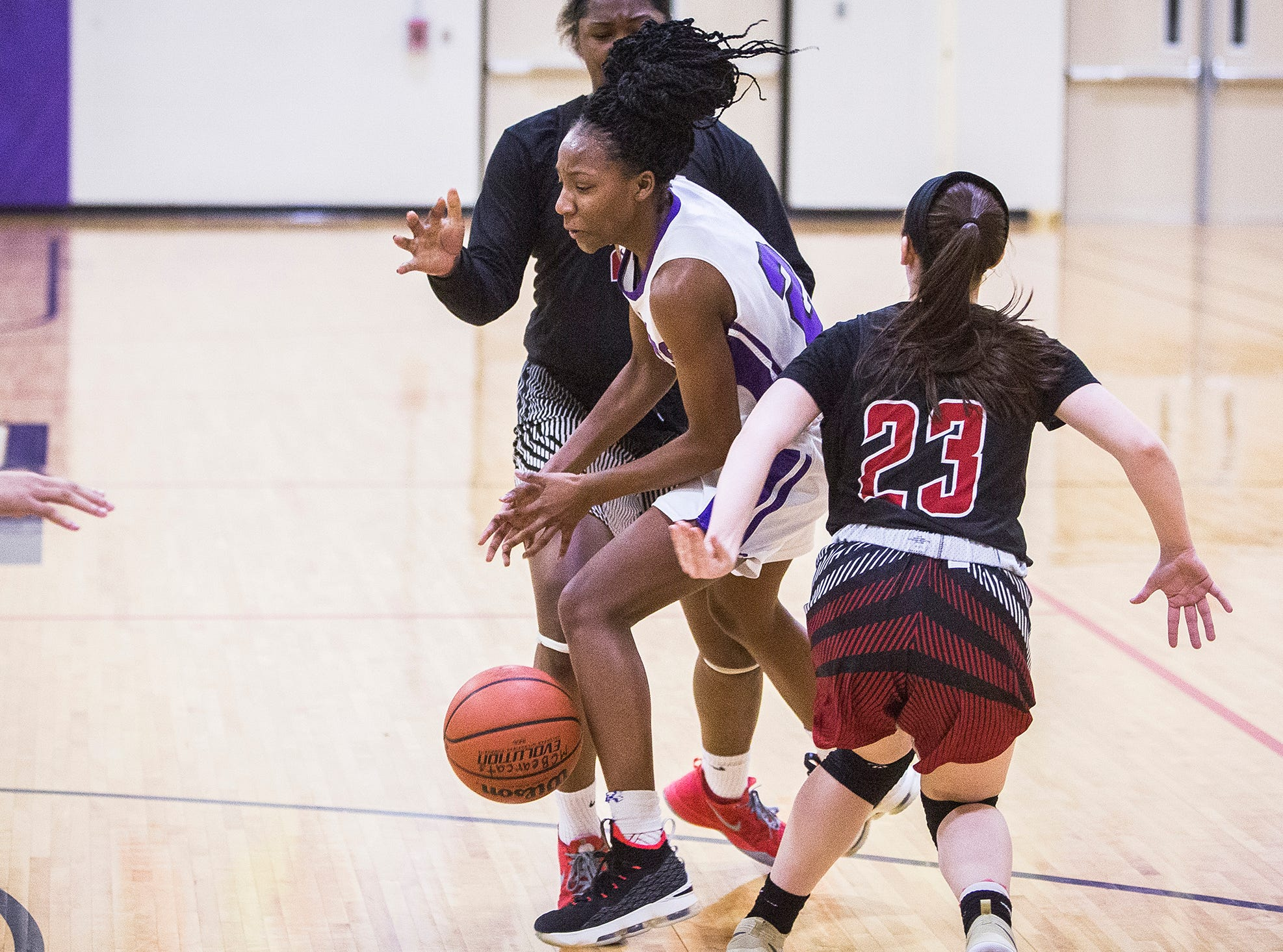 Central's Taydriana Robertson fights past Lafayette Jefferson during their game at Central Friday, Jan. 4, 2019.