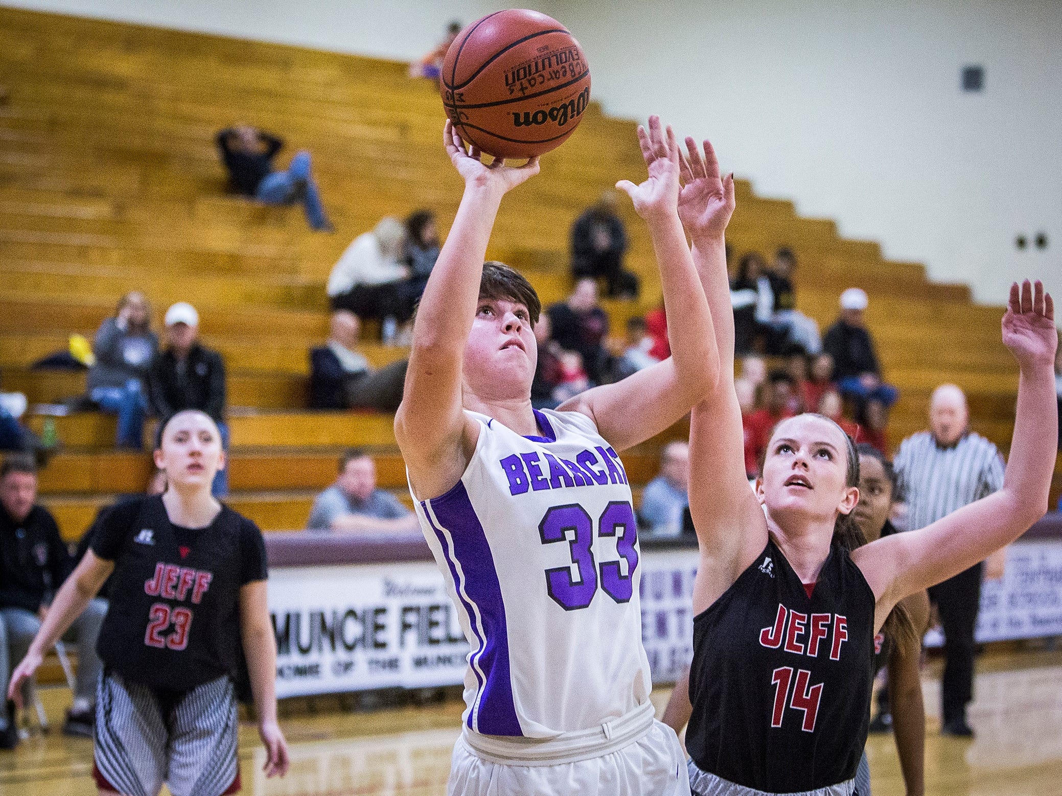 Central's Riley Stafford shoots past Lafayette Jefferson during their game at Central Friday, Jan. 4, 2019.
