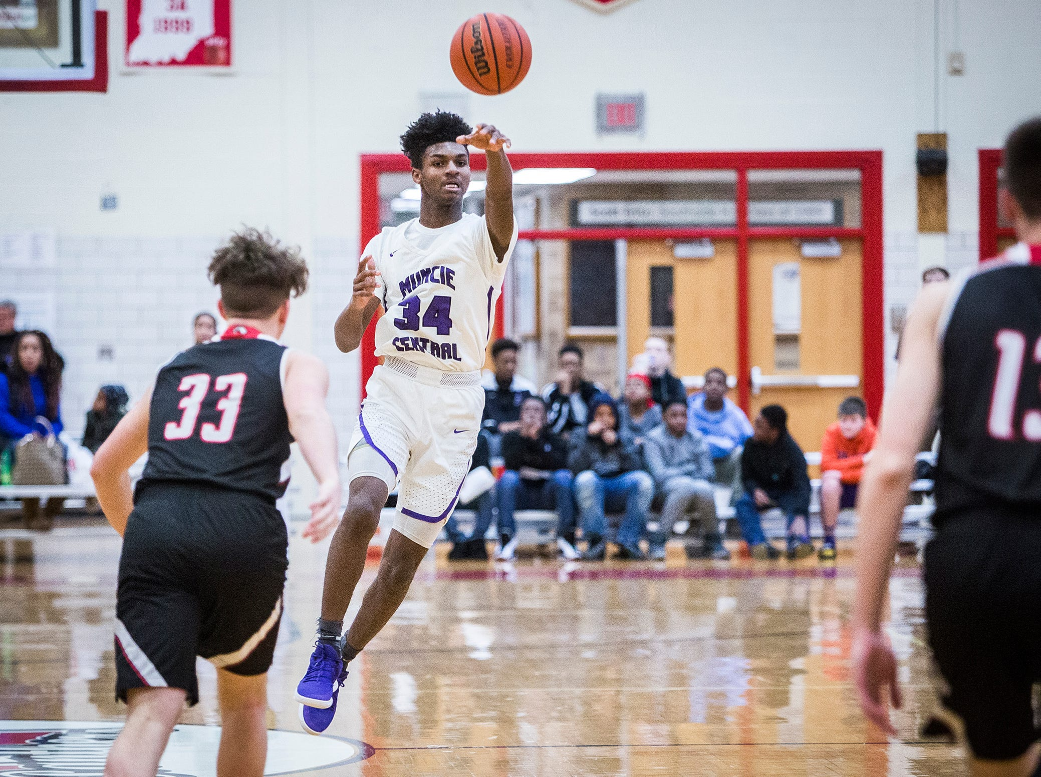 Central's Reggie Bass passes against Lafayette Jefferson during their game at Southside Middle School Friday, Jan. 4, 2019.