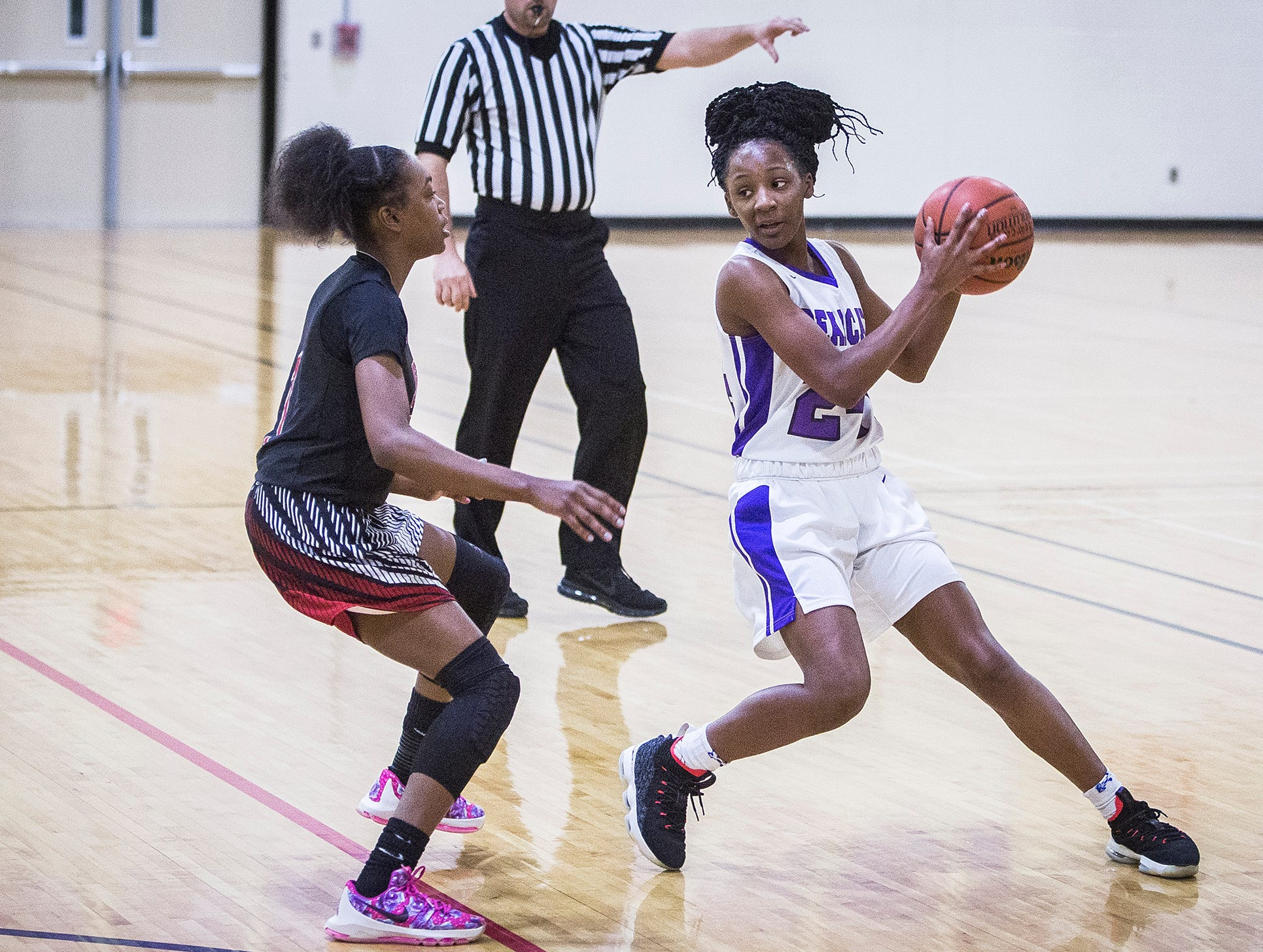 Central's Taydriana Robertson dribbles past Lafayette Jefferson during their game at Central Friday, Jan. 4, 2019.