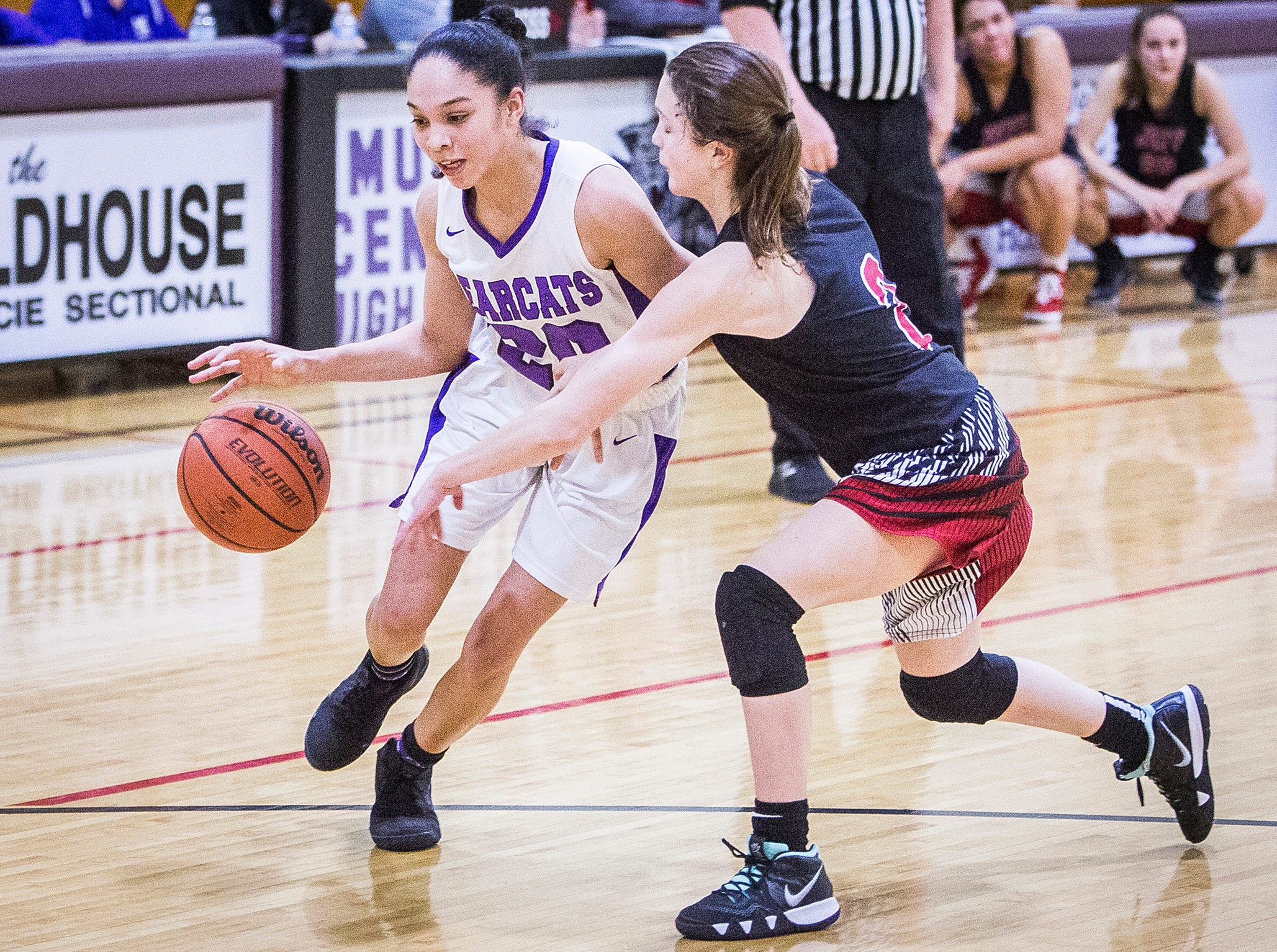 Central's Sayla McIntosh dribbles past Lafayette Jefferson during their game at Central Friday, Jan. 4, 2019.