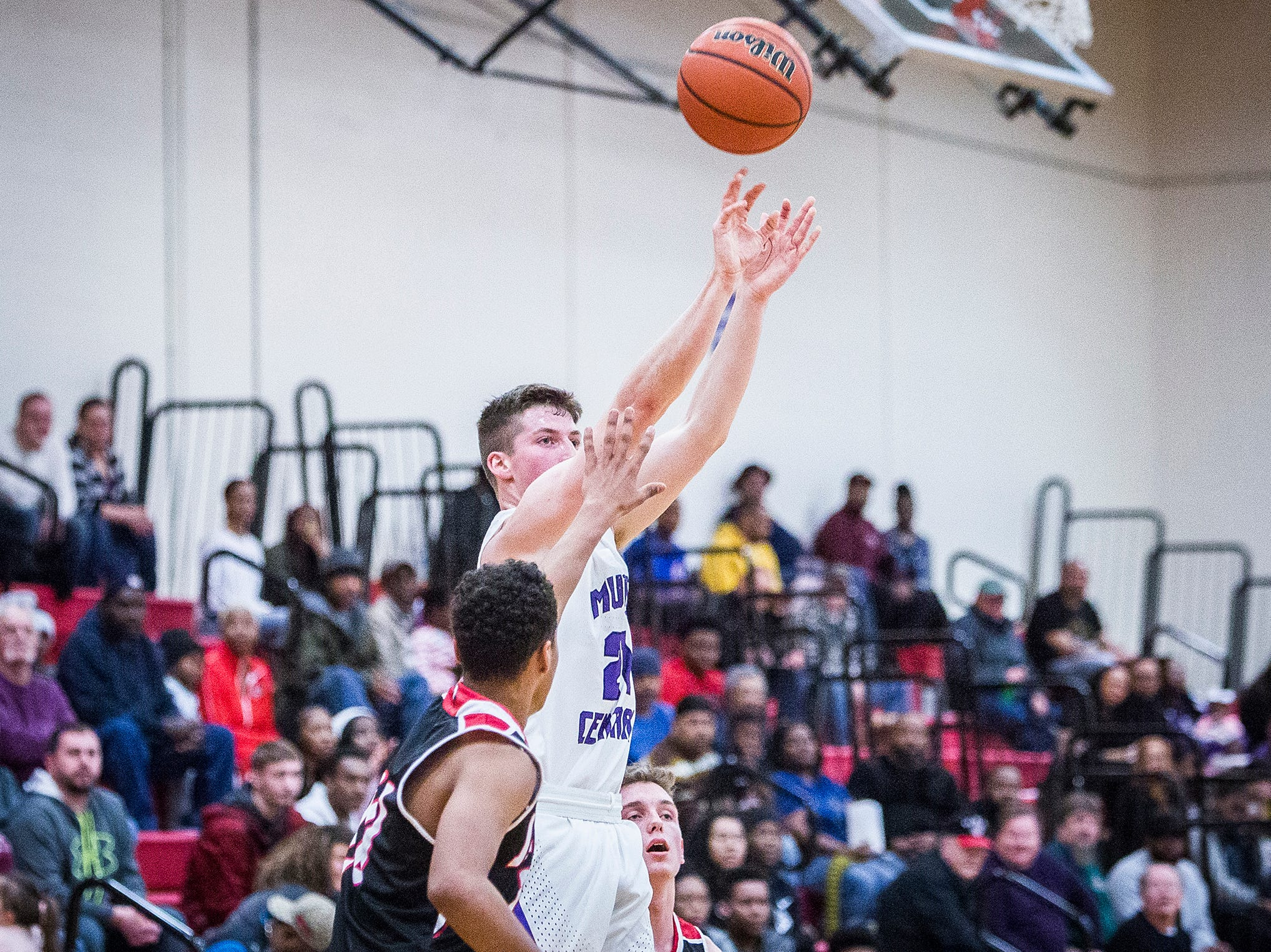 Central's Dylan Stafford shoots against Lafayette Jefferson during their game at Southside Middle School Friday, Jan. 4, 2019.