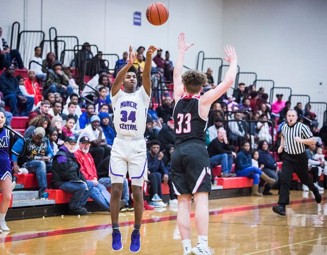 Central freshman Reggie Bass, shown here shooting a jumper against Lafayette Jeff, scored 17 points to lead the Bearcats past Connersville in a make-up game.