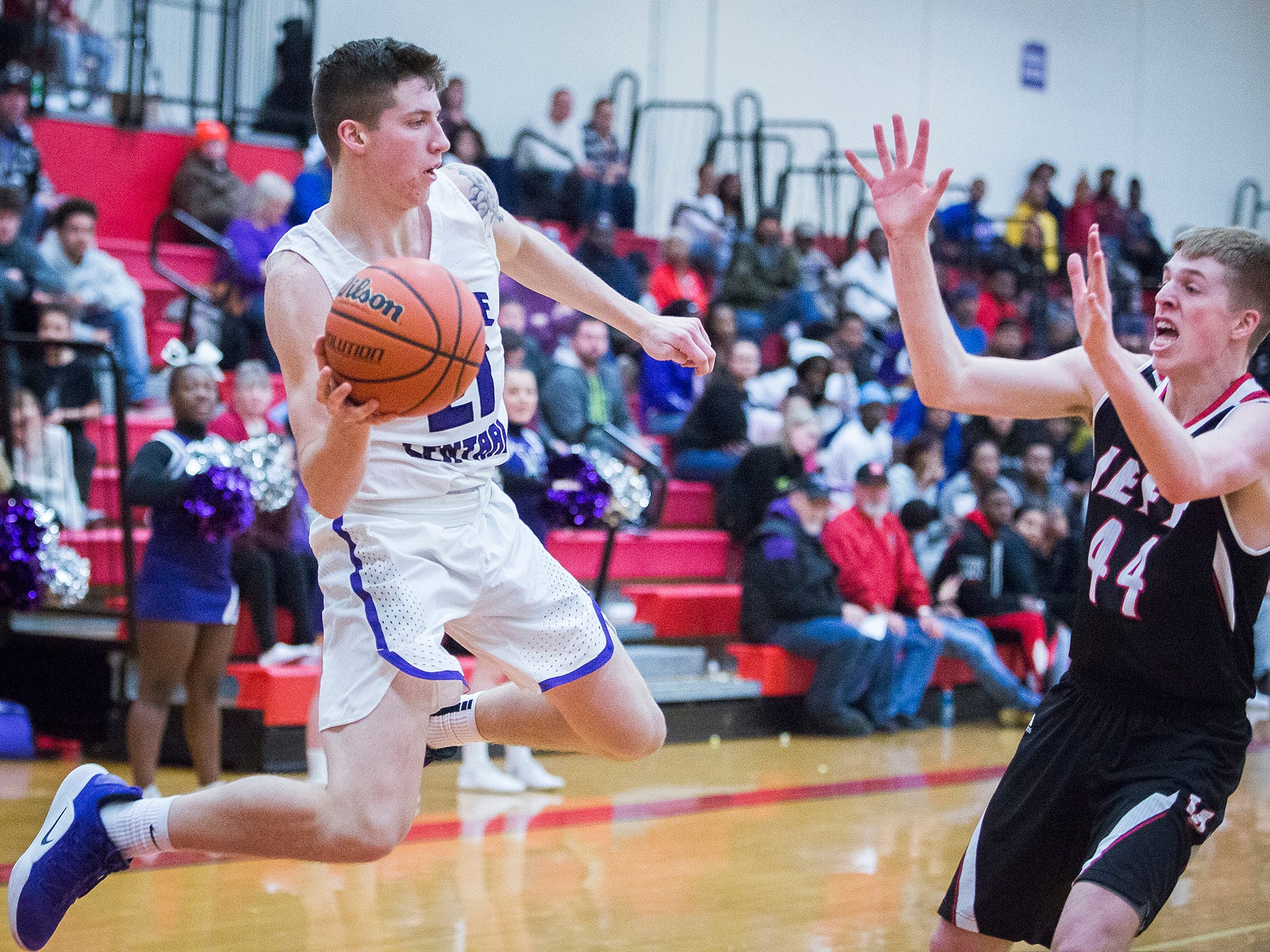 Central's Dylan Stafford looks to pass against Lafayette Jefferson's defense during their game at Southside Middle School Friday, Jan. 4, 2019.