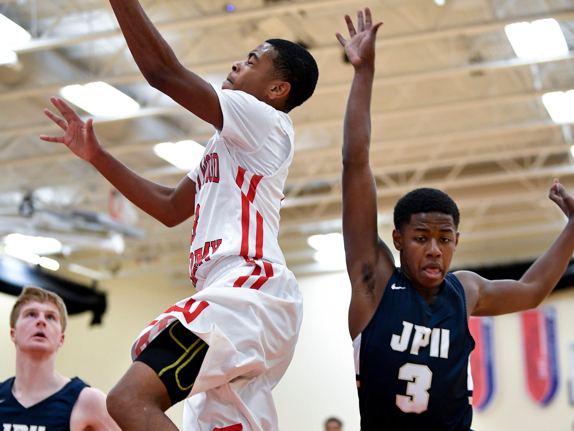 Brentwood Academy's Bj Davis (3) shoots past Pope John Paul II's Timothy Lark (3) during the first half at Brentwood Academy in Brentwood, Tenn., Friday, Jan. 4, 2019.