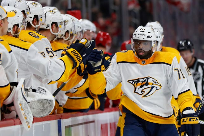 Nashville Predators defenseman P.K. Subban, right, celebrates his goal against the Detroit Red Wings in the first period of an NHL hockey game Friday, Jan. 4, 2019, in Detroit. (AP Photo/Paul Sancya)