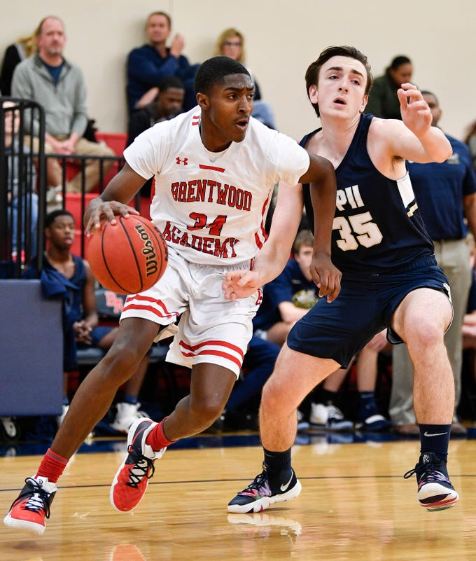 Brentwood Academy's Randy Brady (34) advances past Pope John Paul II's Taggart Patterson (35) during the first half at Brentwood Academy in Brentwood, Tenn., Friday, Jan. 4, 2019.