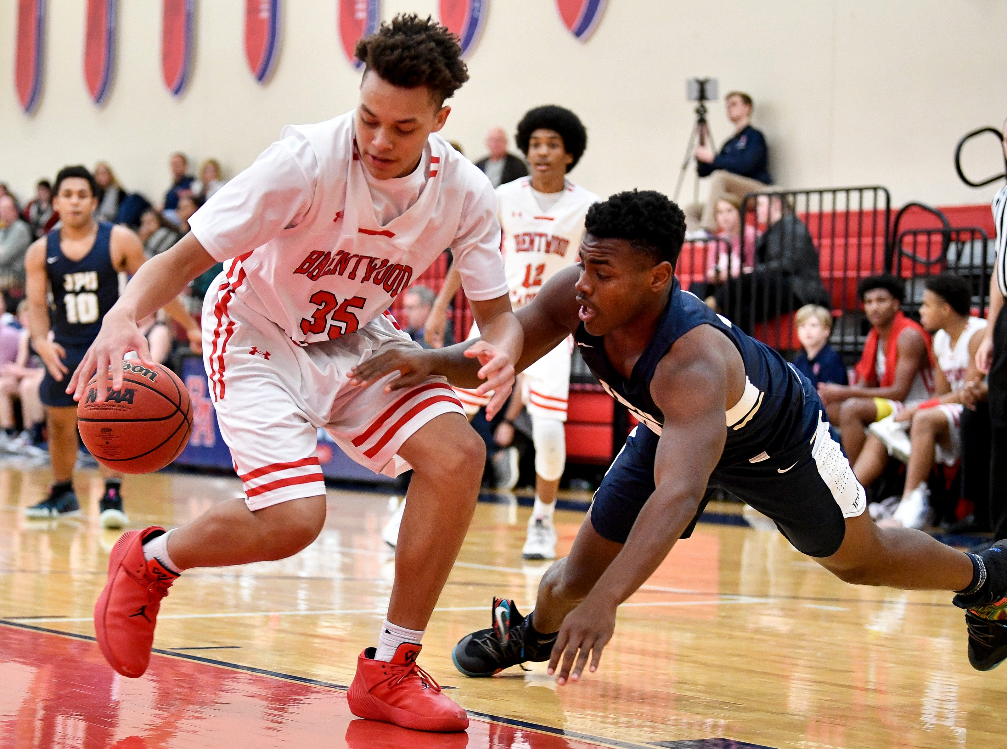 Brentwood Academy's DJ Senter (35) battles Pope John Paul II's Jay Wright (0) during the second half at Brentwood Academy in Brentwood, Tenn., Friday, Jan. 4, 2019.
