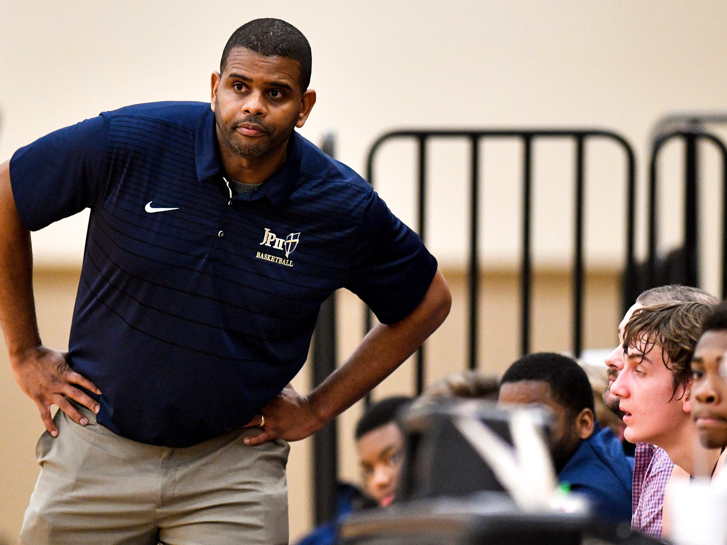 Pope John Paul II head coach Charles Wade watches his team face Brentwood Academy during the second half at Brentwood Academy in Brentwood, Tenn., Friday, Jan. 4, 2019.