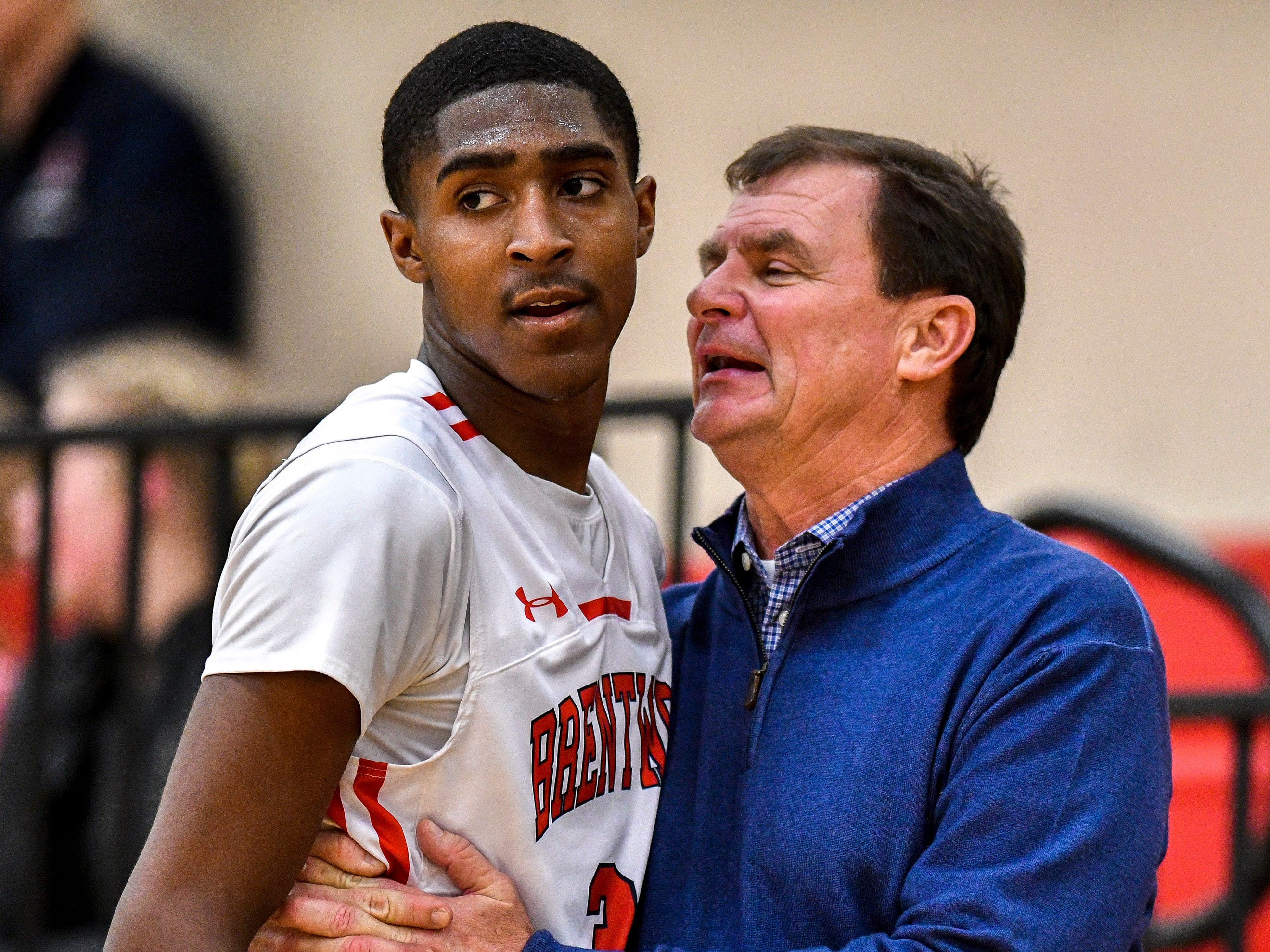 Brentwood Academy's Randy Brady (34) works with head coach Hubie Smith during the second half against Pope John Paul II at Brentwood Academy in Brentwood, Tenn., Friday, Jan. 4, 2019.