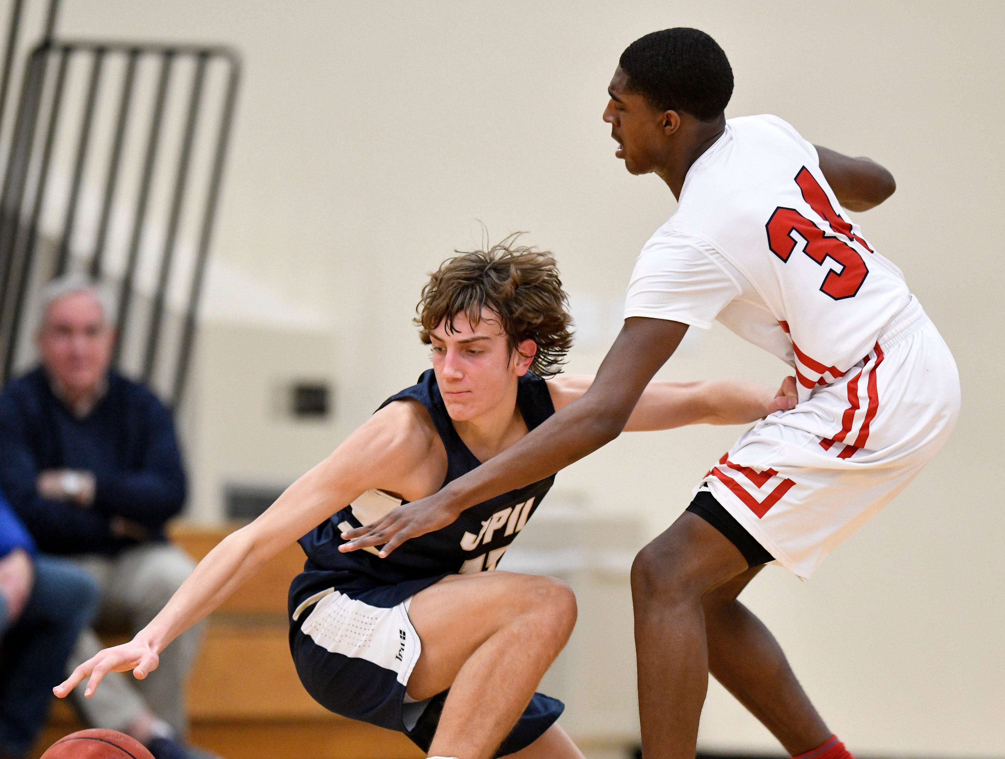 Pope John Paul II's Sam Specht (11) chases a loose ball with Brentwood Academy's Randy Brady (34) during the second half at Brentwood Academy in Brentwood, Tenn., Friday, Jan. 4, 2019.
