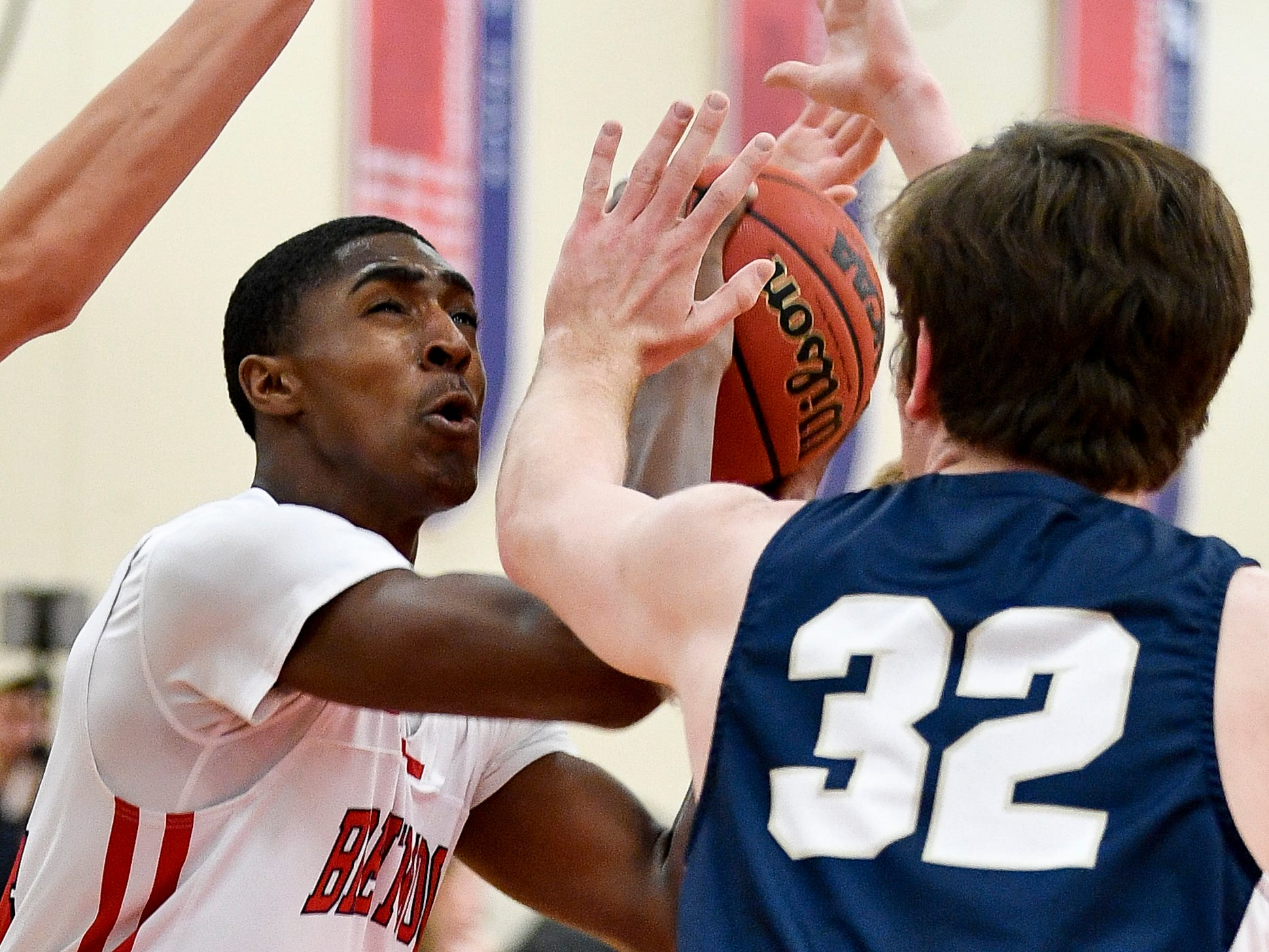 Brentwood Academy's Randy Brady (34) looks for an opening pasr Pope John Paul II's Judson Murray (32) during the first half at Brentwood Academy in Brentwood, Tenn., Friday, Jan. 4, 2019.
