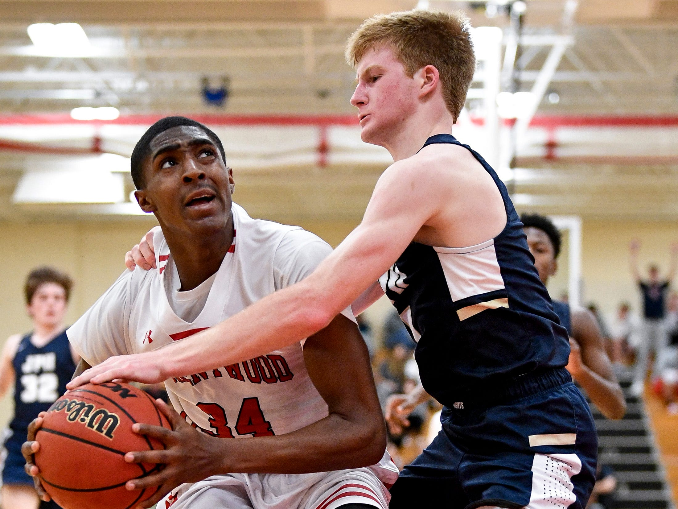Brentwood Academy's Randy Brady (34) is fouled by Pope John Paul II's Michael Martini (1) during the second half at Brentwood Academy in Brentwood, Tenn., Friday, Jan. 4, 2019.