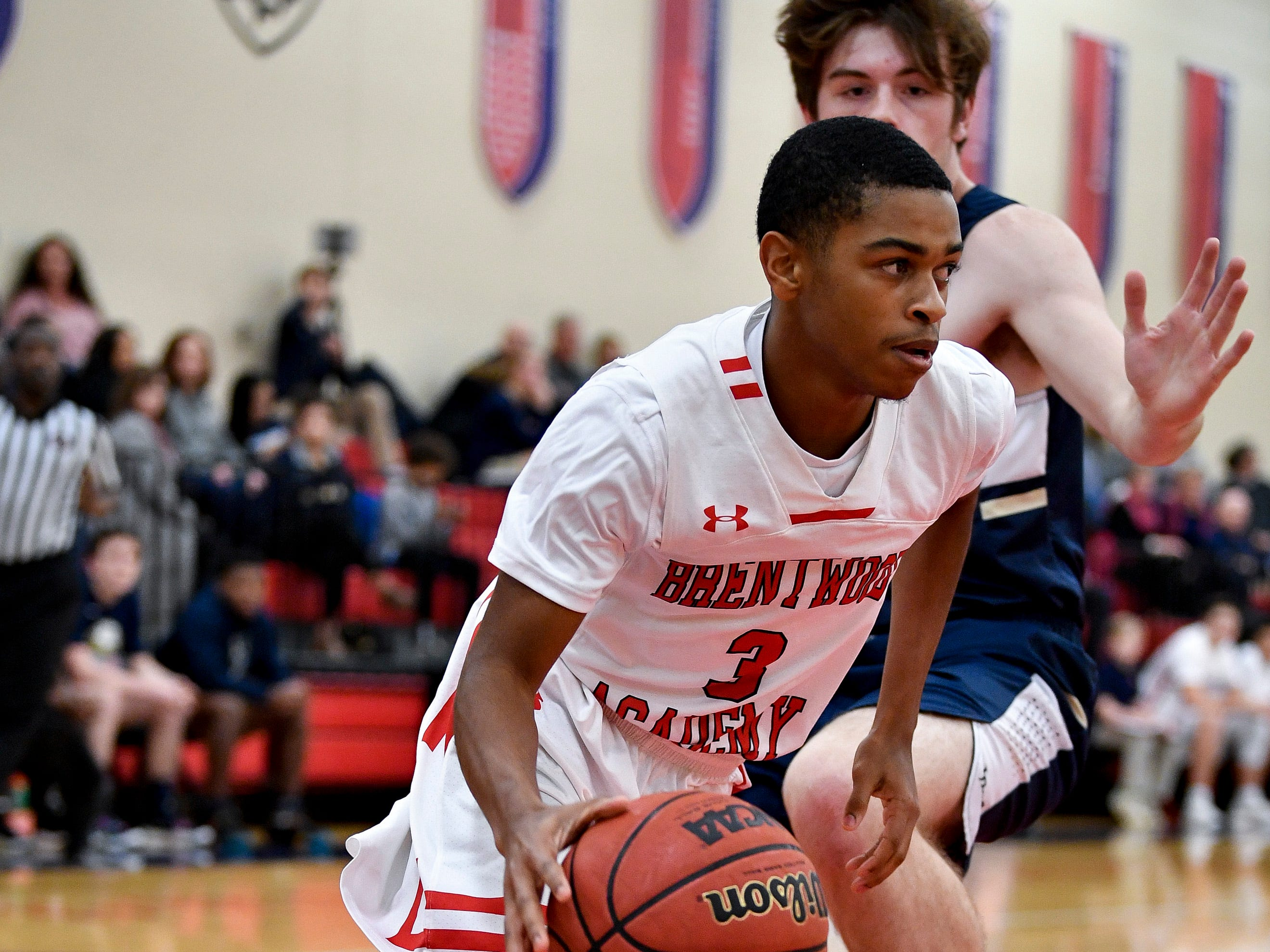 Brentwood Academy's Bj Davis (3) advances past Pope John Paul II's Judson Murray (32) during the first half at Brentwood Academy in Brentwood, Tenn., Friday, Jan. 4, 2019.