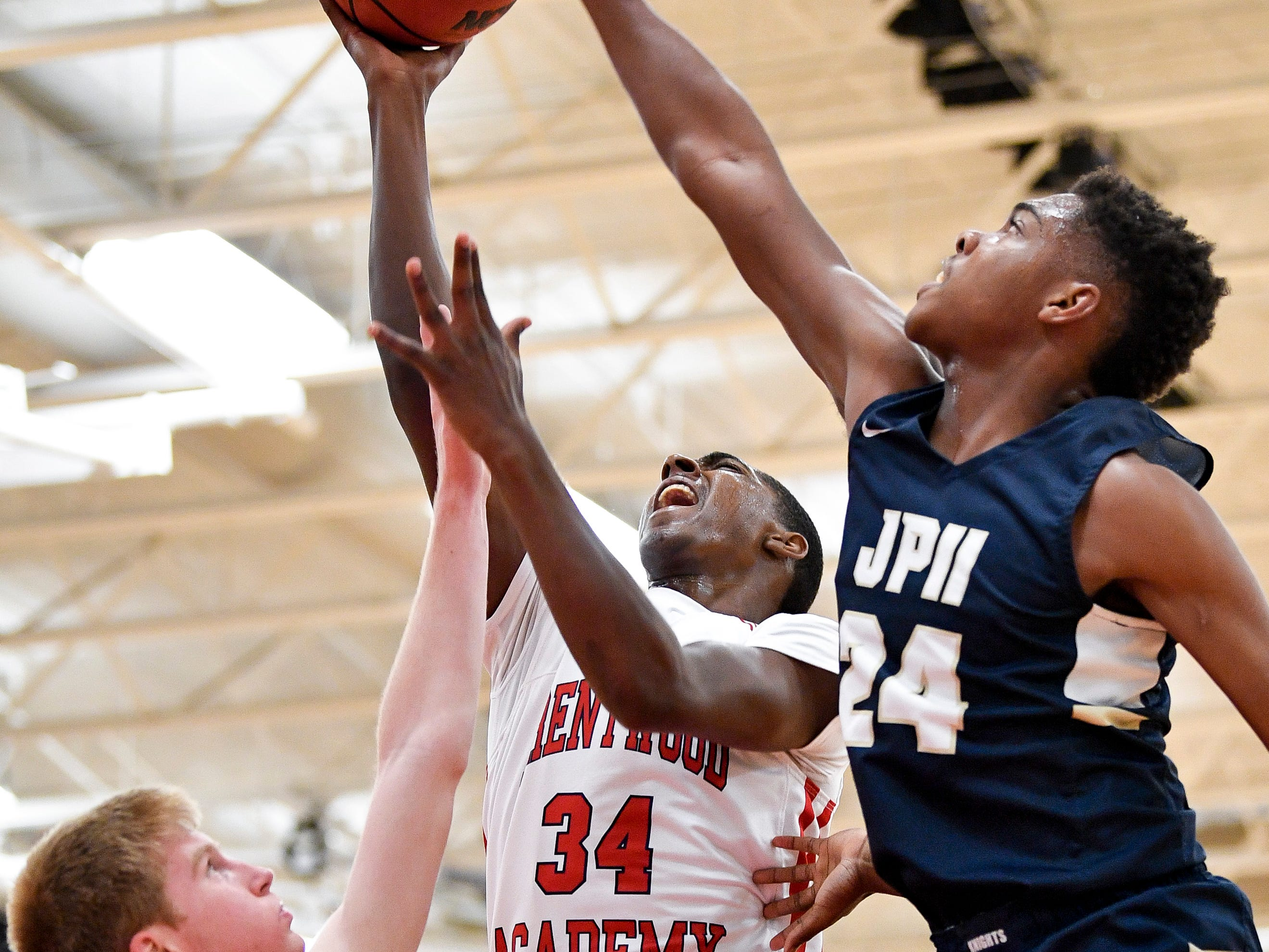 Brentwood Academy's Randy Brady (34) battles Pope John Paul II's Michael Martini (1) and Ben Nixon (24) during the first half at Brentwood Academy in Brentwood, Tenn., Friday, Jan. 4, 2019.