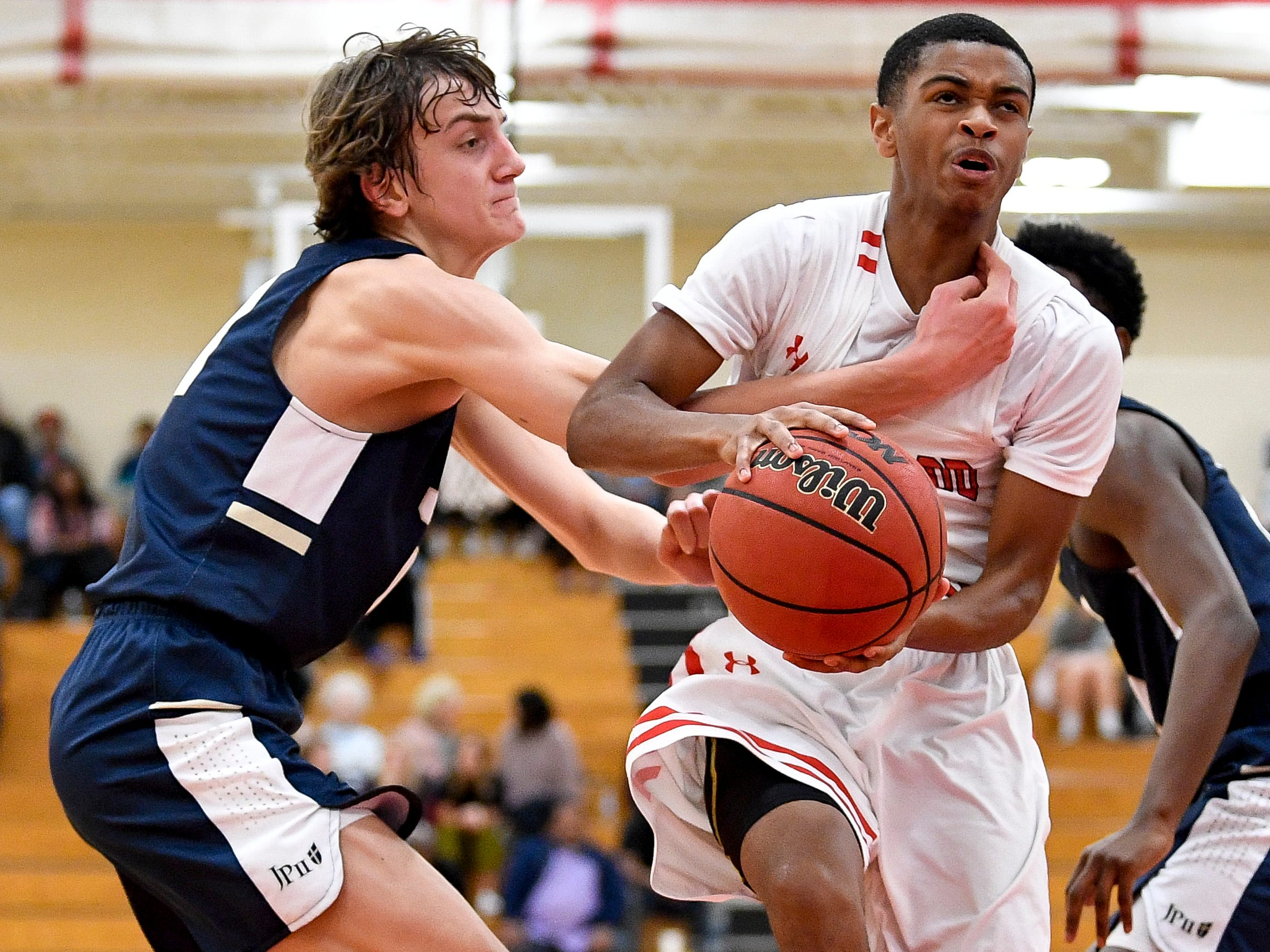 Brentwood Academy's Bj Davis (3) is fouled by Pope John Paul II's Sam Specht (11) during the second half at Brentwood Academy in Brentwood, Tenn., Friday, Jan. 4, 2019.