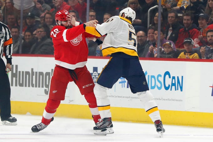 Detroit Red Wings right wing Luke Witkowski (28) and Nashville Predators left wing Austin Watson (51) fight in the first period of an NHL hockey game Friday, Jan. 4, 2019, in Detroit. (AP Photo/Paul Sancya)