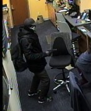 A surveillance picture of a suspect police say robbed a bank in Franklin Friday, Jan. 4, 2019.