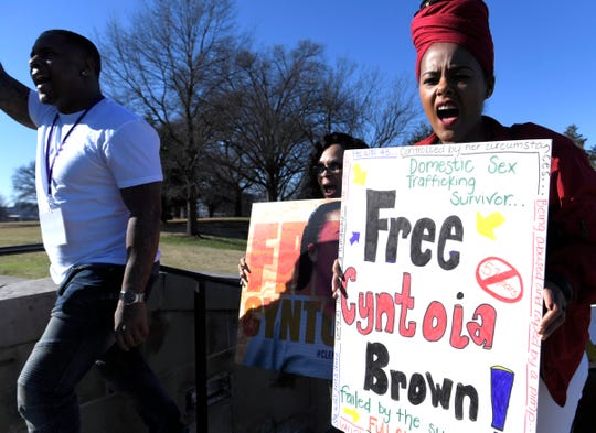 Ebony Jones, right, and others march from Bicentennial Mall to Tennessee State Capitol on Saturday,  Jan. 5, 2019 in support for clemency for Cyntoia Brown.