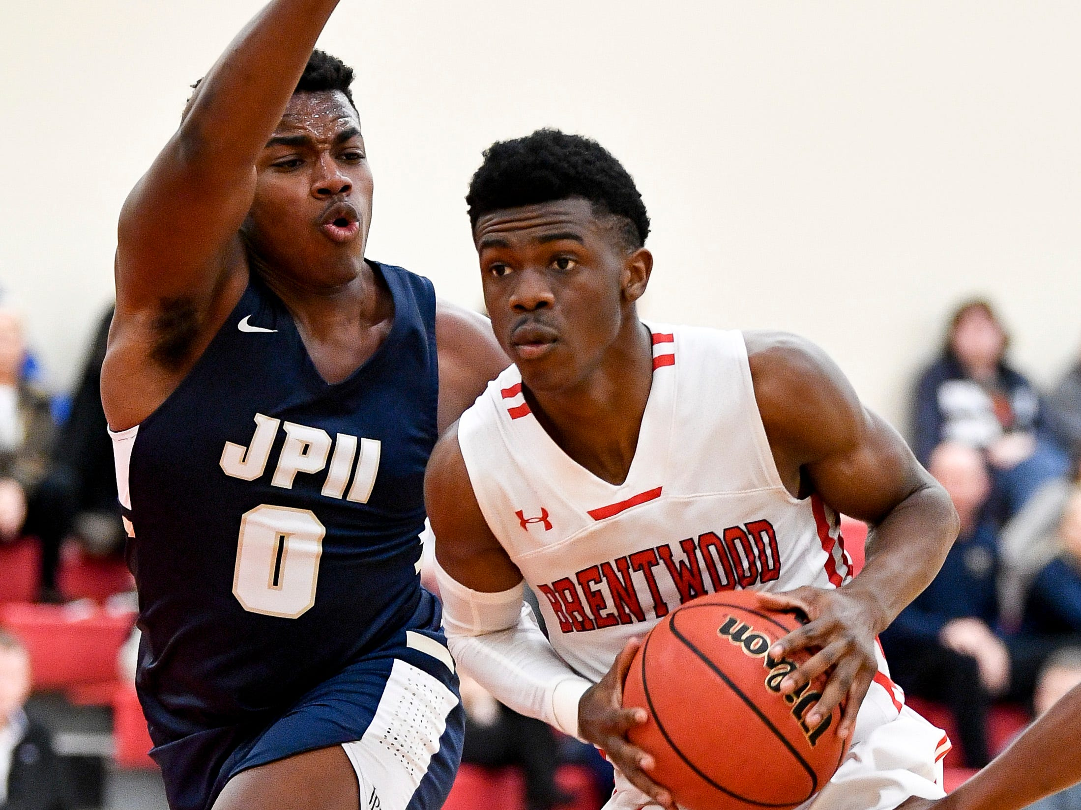 Brentwood Academy's Marcus Fitzgerald jr. (5) battles Pope John Paul II's Jay Wright (0) during the second half at Brentwood Academy in Brentwood, Tenn., Friday, Jan. 4, 2019.