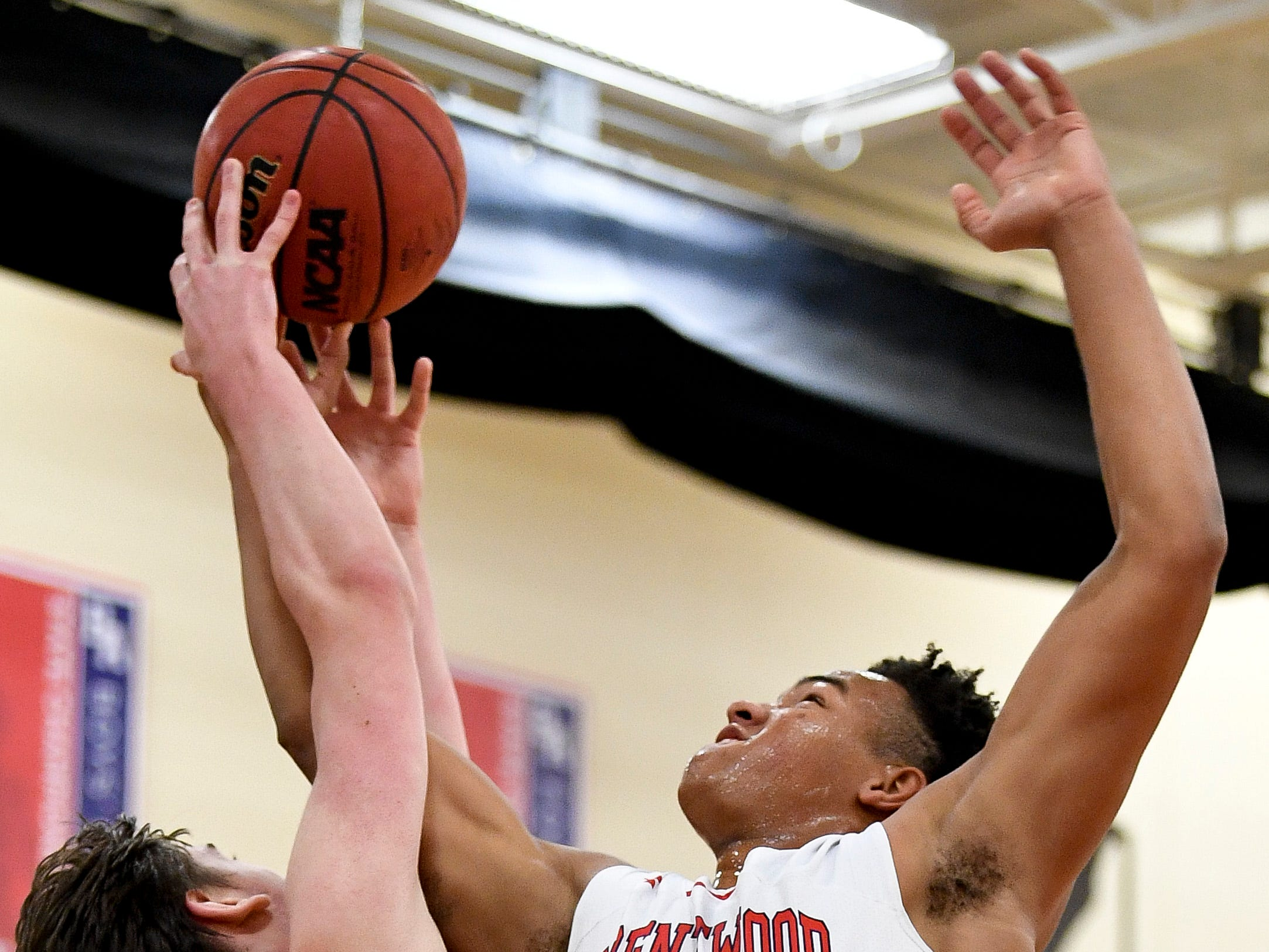 Pope John Paul II's Taggart Patterson (35) battles Brentwood Academy's Nate Clifton (45) during the first half at Brentwood Academy in Brentwood, Tenn., Friday, Jan. 4, 2019.