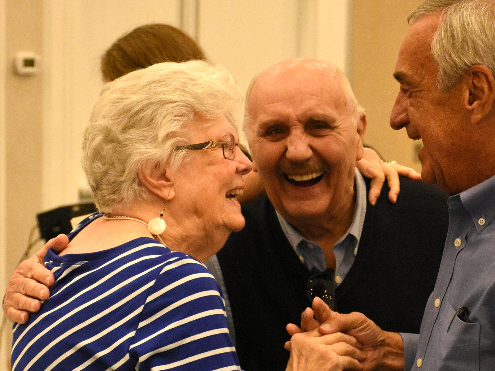 Emily Savage shares a moment with Mitch Peters and Jim Stackpoole on Saturday, Jan. 5, 2019, as Marco Island paid tribute to her husband, island pioneer Herb Savage, who would have turned 100 years old Sunday but died five days short of the century mark. The birthday party at the Hilton Marco Island instead became a celebration of life.