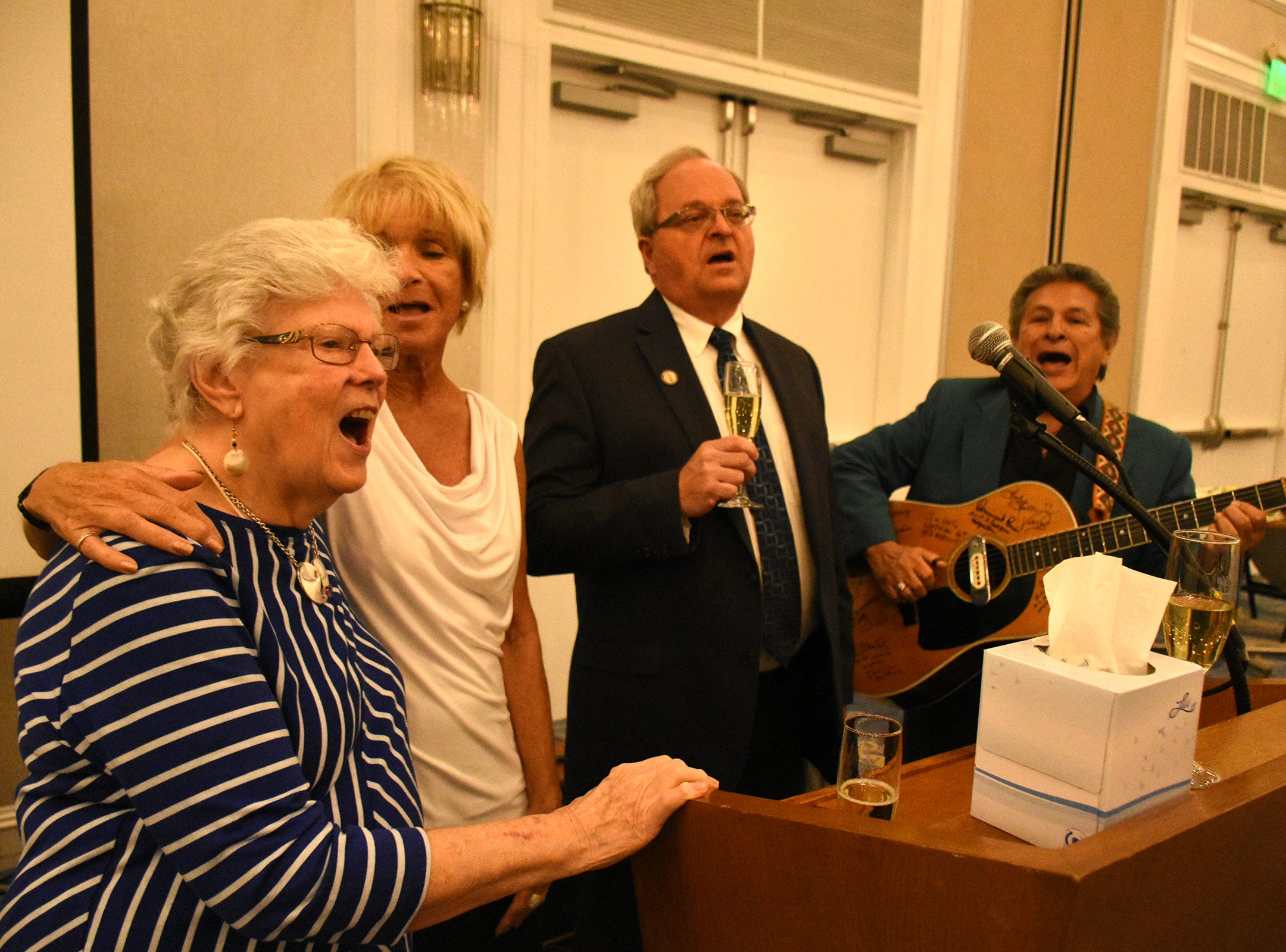"Herb Savage's wife, Emily Savage, left, joins Debra Shanahan, Craig Woodward and Frankie Ray in singing ""Happy Birthday."" Marco Island paid tribute on Saturday, Jan. 5, 2019, to Herb Savage, who would have turned 100 years old on Sunday but died five days short of the century mark. The birthday party at the Hilton Marco Island instead became a celebration of his life."