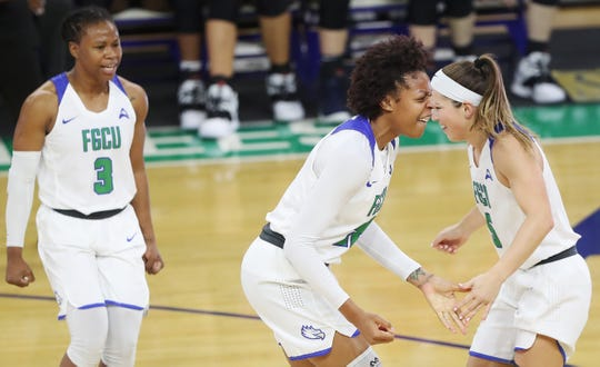 FGCU's Destiny Washington, center, celebrates scoring against Liberty on Saturday at Alico Arena in Fort Myers.