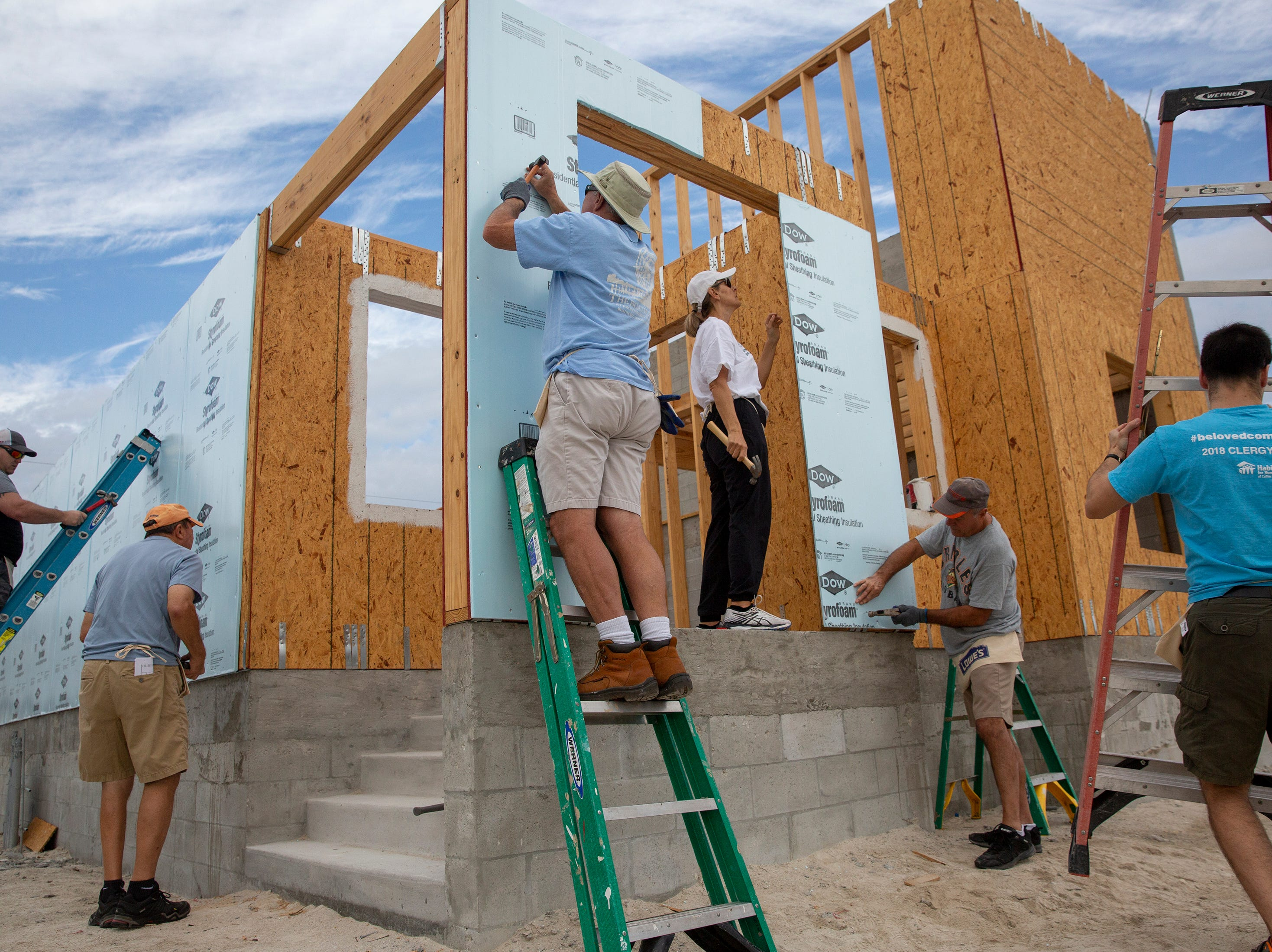 Local veterans and volunteers with Habitat for Humanity of Collier County work together to help build homes Saturday, Jan. 5, 2019, in the Dockside neighborhood in East Naples.