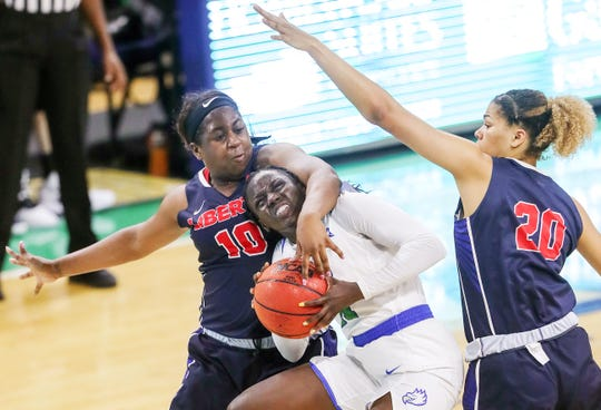 FGCU's Nasrin Ulel, center, is fouled by Liberty's Kierra Johnson-Graham on Saturday at Alico Arena in Fort Myers. Ulel made both of her fouls shots.
