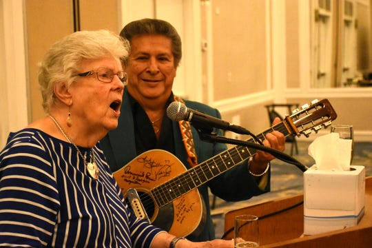 """Herb Savage's wife, Emily Savage, and guitarist Frankie Ray lead the singing of """"God Bless America,"""" a Savage tradition. Marco Island paid tribute on Saturday, Jan. 5, 2019, to island pioneer Herb Savage, who would have turned 100 years old on Sunday but died five days short of the century mark. The birthday party at the Hilton Marco Island instead became a celebration of life."""