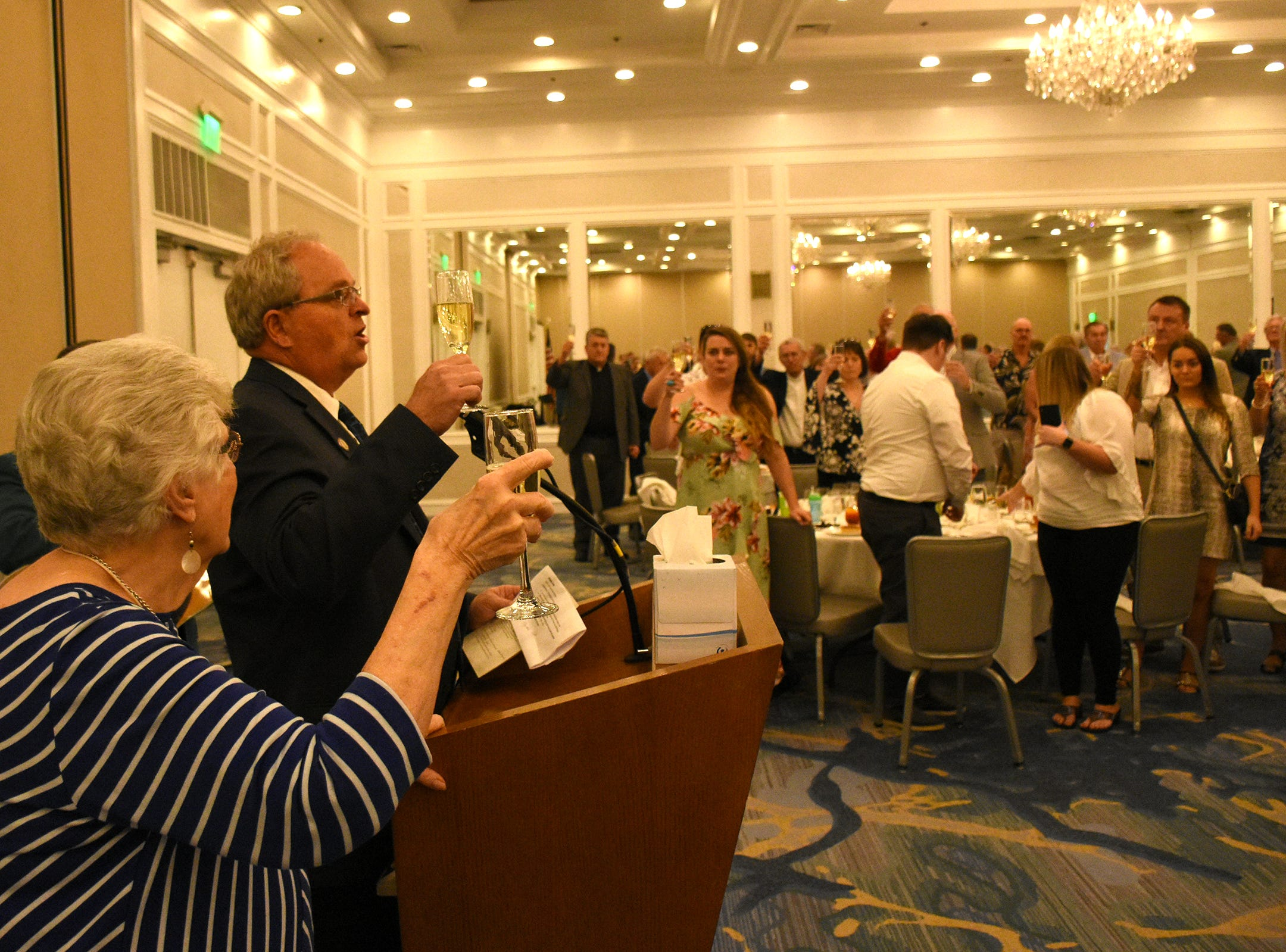 Herb Savage's wife, Emily Savage, joins emcee Craig Woodward in a toast to her late husband. Marco Island paid tribute on Saturday, Jan. 5, 2019, to Herb Savage, who would have turned 100 years old on Sunday but died five days short of the century mark. The birthday party at the Hilton Marco Island instead became a celebration of his life.