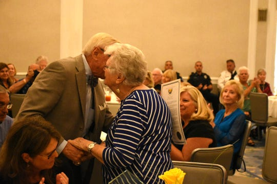 Herb Savage's wife, Emily Savage, receives a proclamation from Marco Island City Council Chairman Erik Brechnitz and gives him a kiss. Marco Island paid tribute on Saturday, Jan. 5, 2019, to Herb Savage, who would have turned 100 years old on Sunday but died five days short of the century mark. The birthday party at the Hilton Marco Island instead became a celebration of his life.