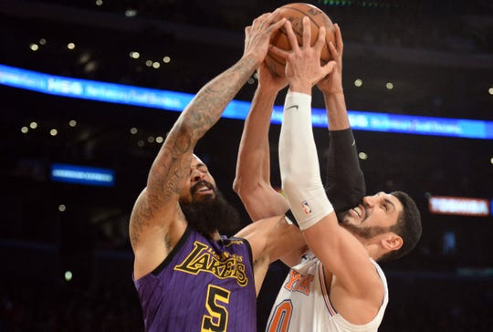 January 4, 2019; Los Angeles, CA, USA; Los Angeles Lakers center Tyson Chandler (5) and New York Knicks center Enes Kanter (00) play for the ball during the second half at Staples Center.