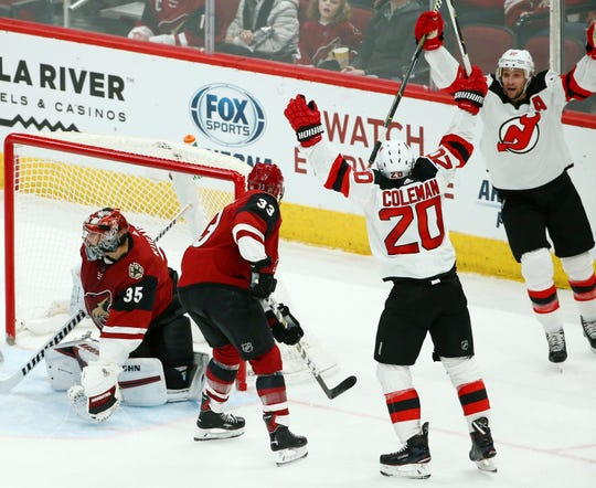 New Jersey Devils center Blake Coleman (20) celebrates his goal with Devils center Travis Zajac, right, as Arizona Coyotes goaltender Darcy Kuemper (35) and defenseman Alex Goligoski (33) look for the puck during the second period of an NHL hockey game Friday, Jan. 4, 2019, in Glendale, Ariz.