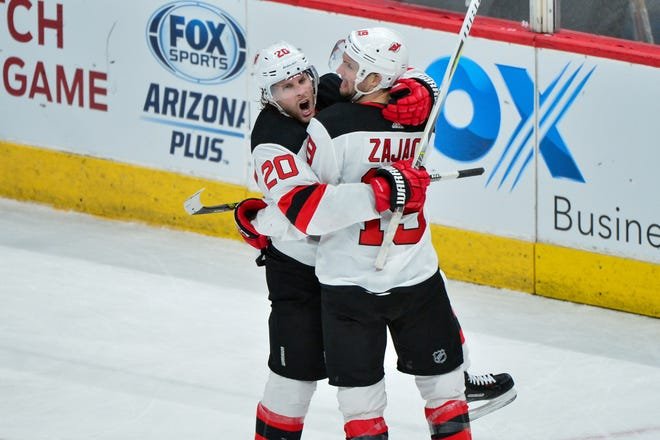 Jan 4, 2019; Glendale, AZ, USA; New Jersey Devils center Blake Coleman (20) celebrates with New Jersey Devils center Travis Zajac (19) after scoring a goal in the second period against the Arizona Coyotes at Gila River Arena.