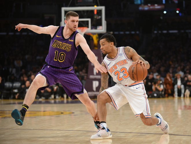 January 4, 2019; Los Angeles, CA, USA; New York Knicks guard Trey Burke (23) moves the ball against Los Angeles Lakers guard Sviatoslav Mykhailiuk (10) during the first half at Staples Center.