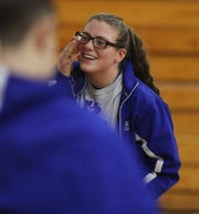 Teaneck senior Erin Emery cheered on her team mates after her 182 lb. match, when she was pinned by Roman Gil of Leonia-PalPark. She is a girl on the Teaneck boys wrestling team as they take on Leonia-PalPark on January 5, 2019. This is the first year NJ is sponsoring girls wrestling as an official sport.