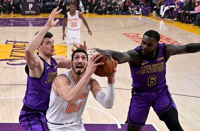 New York Knicks center Enes Kanter, center, tries to shoot as Los Angeles Lakers center Ivica Zubac, left, and guard Lance Stephenson defend during the first half of an NBA basketball game Friday, Jan. 4, 2019, in Los Angeles.