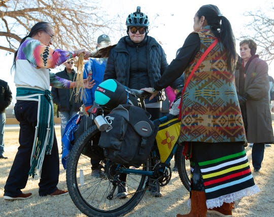 New Mexico State Representative Angelica Rubio takes off on bicycle to Santa Fe from Las Cruces on Saturday, Jan. 5, 2019, for the 2019 legislative session at Klein Park. Before beginning her ride, Rubio receives a tribal blessing by the Piro Manso-Tiwa Indian Tribe del Pueblo de San Juan de Guadalupe. The event was organized by Las Esperanzas, Inc.