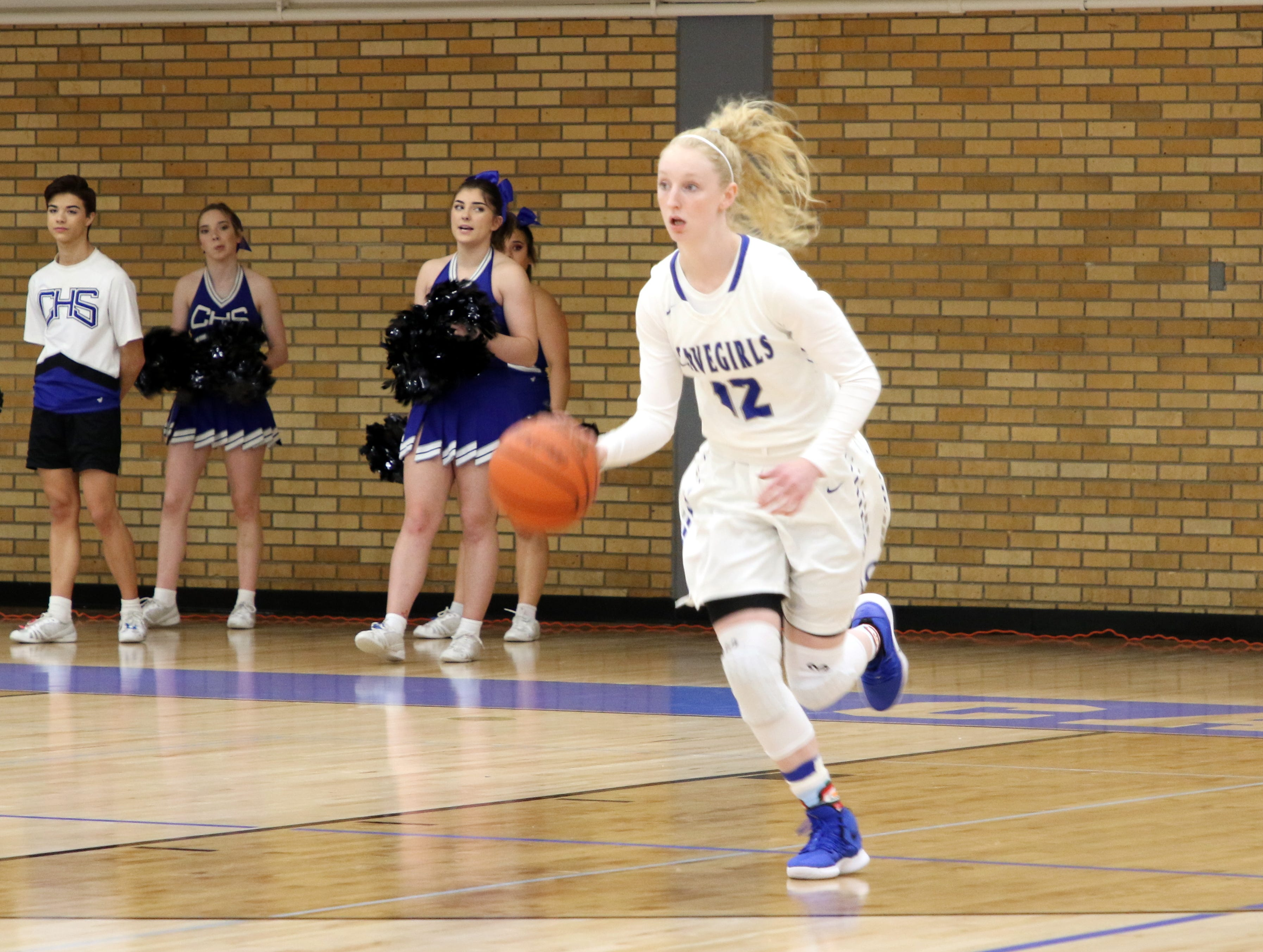 Carsyn Boswell takes the ball down the court against Mayfield. Boswell led all scorers with 15 points.